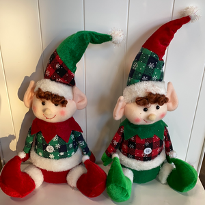 Red and green sitting holiday elves