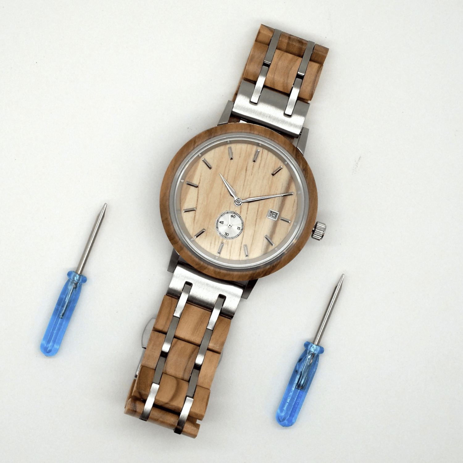 Wooden watch and two small screwdrivers