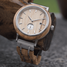 Load image into Gallery viewer, Olive wood and stainless steel watch hanging on tree branch