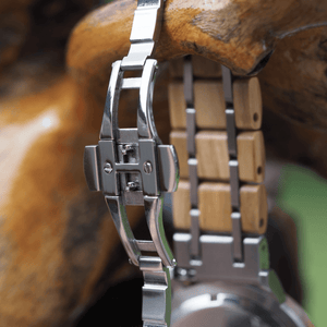 Open metal back closure on stainless steel and olive wood watch