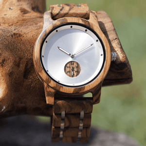 zebrawood and stainless steel wooden watch with subdial on a branch