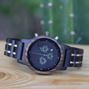 ebony, zebrawood, and stainless steel watch on wood