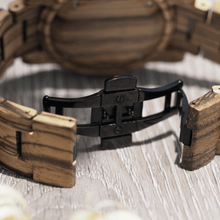 Load image into Gallery viewer, Black metal hidden closure on zebrawood watch