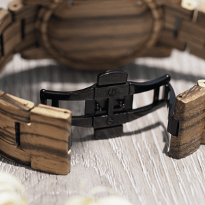 Black metal hidden closure on zebrawood watch