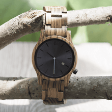 Load image into Gallery viewer, Zebrawood wooden watch hanging off of a tree branch