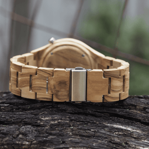 Metal back closure on zebrawood watch