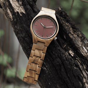 Zebrawood wooden watch hanging on a branch