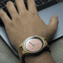 Load image into Gallery viewer, Person wearing wooden watch while working on computer