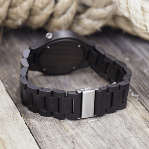 Metal back closure on ebony wooden watch