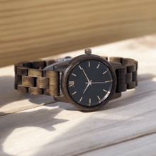 Load image into Gallery viewer, Walnut wooden watch laying on its side