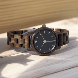 Walnut wooden watch laying on its side