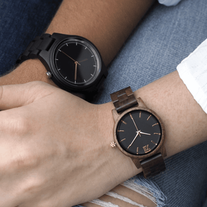 Two people wearing dark wooden watches
