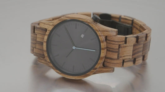 Zebrawood watch spinning on turntable