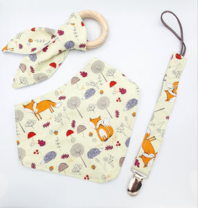 Bib, teether and dummy clip combo, foxes in the field