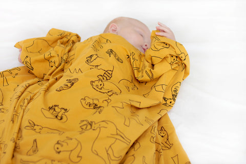 Organic cotton stretchy swaddle - Woodland print - Mustard