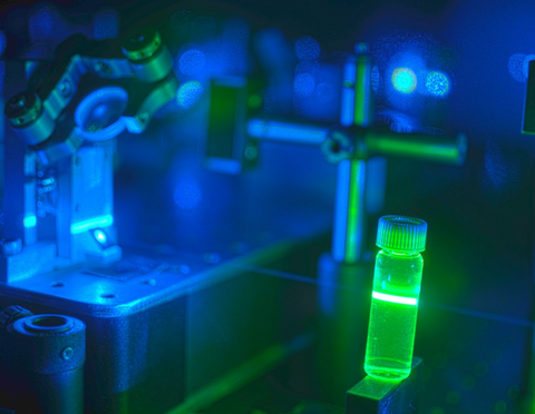 A 488-nm laser beam exciting fluorescence in a solution containing a green-emitting fluorophore, Alexa488.