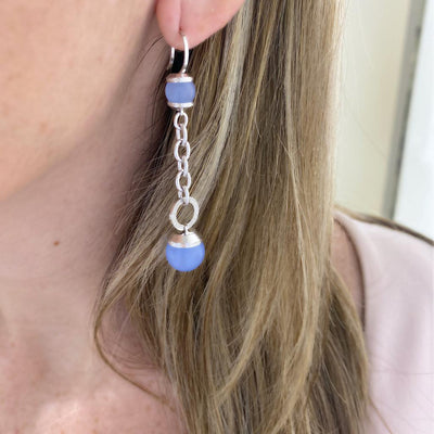 Hollywood Long Frosty Blue Earrings by REBECCA - Available at SHOPKURY.COM. Free Shipping on orders over $200. Trusted jewelers since 1965, from San Juan, Puerto Rico.