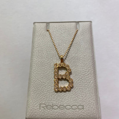 B Initial Bling Pendant Rose/Champagne by Rebecca - Available at SHOPKURY.COM. Free Shipping on orders over $200. Trusted jewelers since 1965, from San Juan, Puerto Rico.