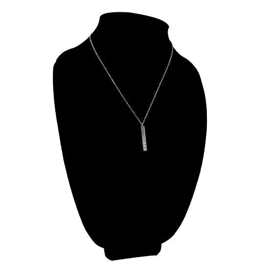 Vertical polished stainless steel stampable necklace with three holes for birthstones on a black velvet bust.