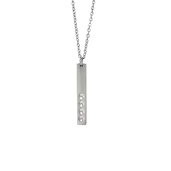 Vertical polished stainless steel stampable necklace with four holes for birthstones hanging.