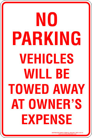 NO PARKING VEHICLES WILL BE TOWED AT OWNERS EXPENSE