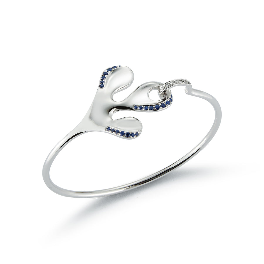 Sea Leaf bracelet 18K white gold with large leaf motif, white diamonds on closure and blue sapphires
