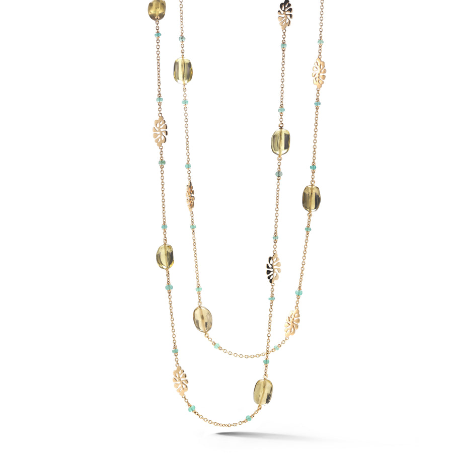 Long chain necklace featuring emeralds and citrine stones