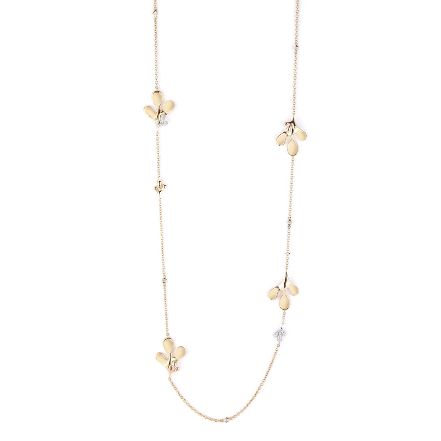 Long necklace in 18K yellow gold with large leaf motif and small leaf motifs, pave white diamonds