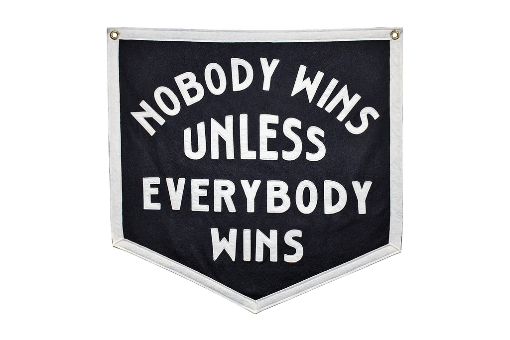 Nobody Wins Unless Everybody Wins Black Banner, white border, white letters