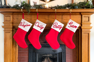 "Custom felt stocking handmade in Buffalo by Oxford Pennant! Measures 14"" x 19"". Names are cut and hand-sewn using traditional wool felt.   Stockings are produced and shipped weekly. Further customizations (i.e. font, color) are not available. 10 character limit."