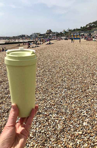 green reusable travel cup