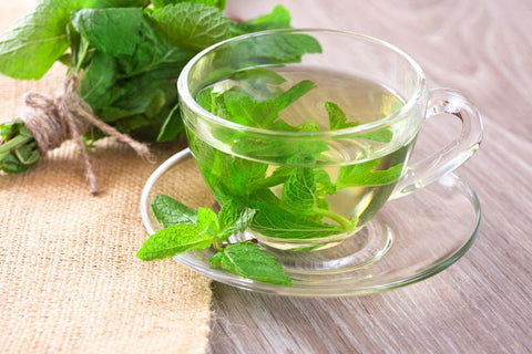 mint tea in clear cup