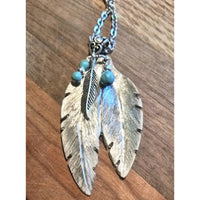 Double feather pendant