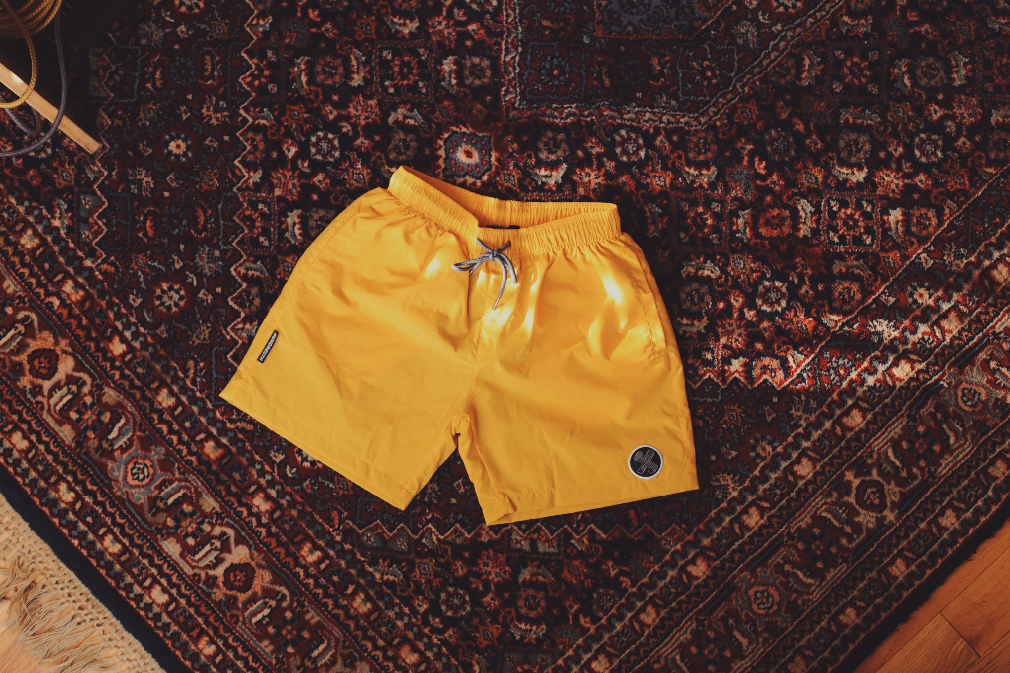 THE BEACH SHORTS (MUSTARD)