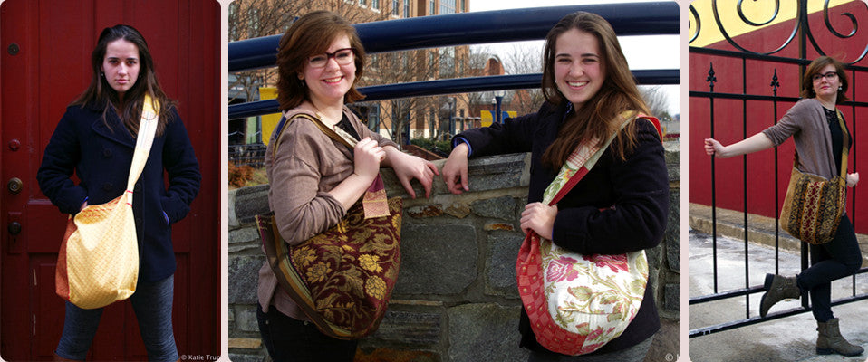 Picture image of two young girls on a bridge each holding a CA Penny Design handbag.