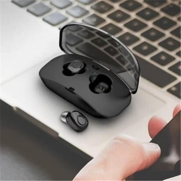True Wireless Earbuds Headset Stereo Noise Cancelling Bluetooth 4.2 on Laptop Keyboard illustrating small size