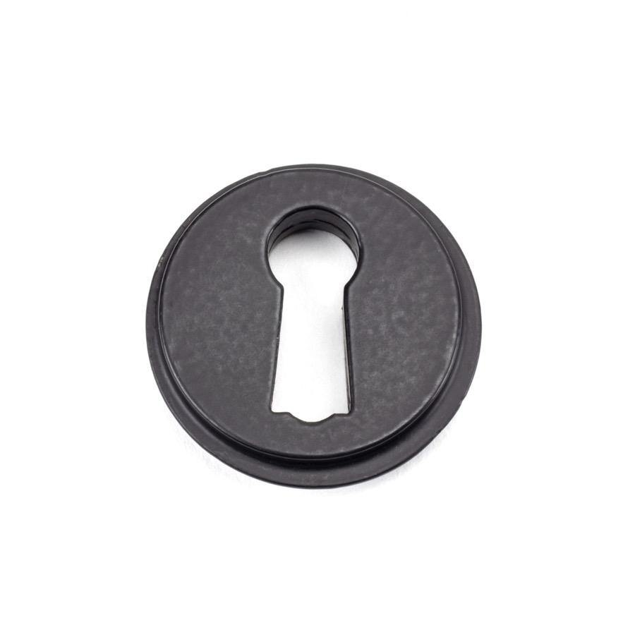 From the Anvil Matt Black Round Escutcheon (Plain) - No.42 Interiors