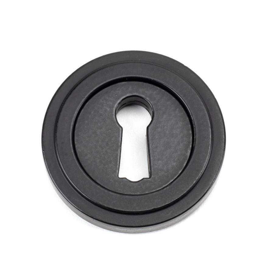 From the Anvil Matt Black Round Escutcheon (Art Deco) - No.42 Interiors