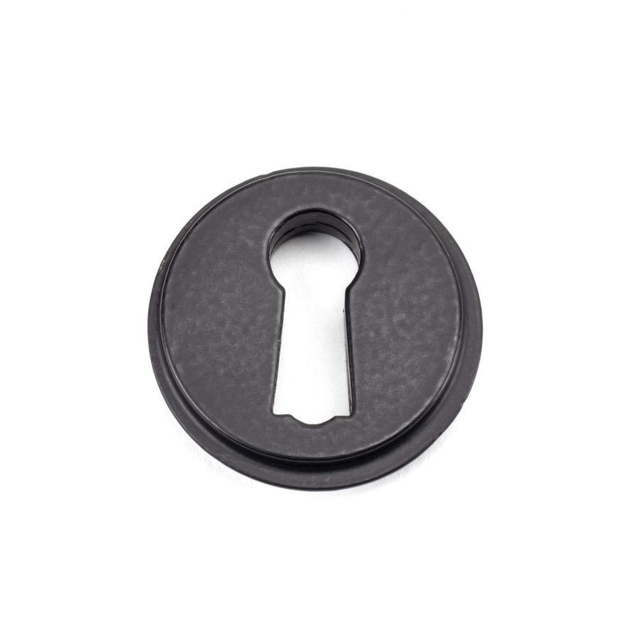 From the Anvil Matt Black Round Escutcheon (Beehive) - No.42 Interiors
