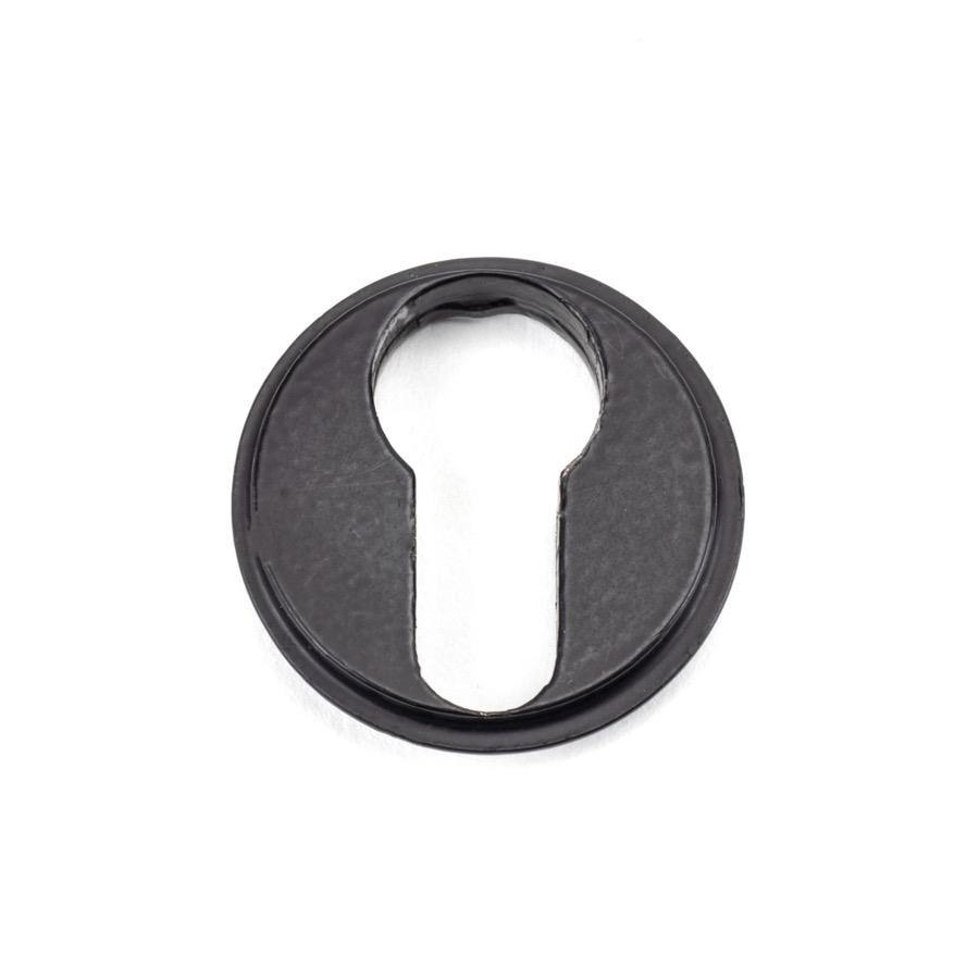 From the Anvil Matt Black Round Euro Escutcheon (Beehive) - No.42 Interiors