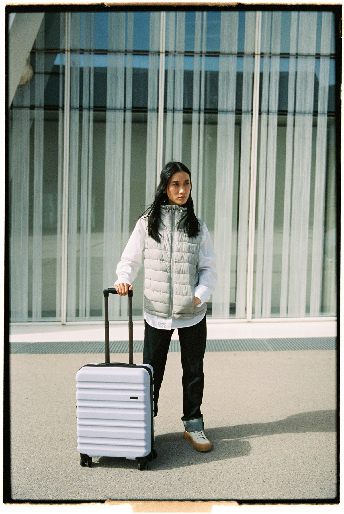 Image of Antler Clifton suitcase in grey with model