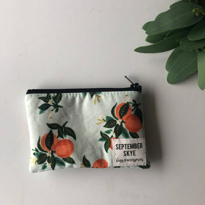 Mini coin purse in peach print with blue background - Sass Beauty Lashes & Skincare