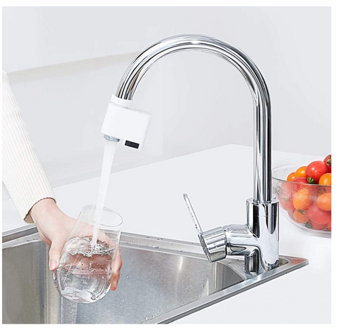 Sensor faucet water flowing into glass