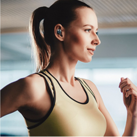 Running woman wearing comfortable 5G Bluetooth Earbuds