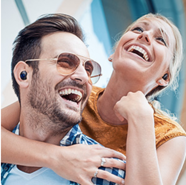 Happy couple enjoying listening to music together with paired 5G Wireless Earbuds Together Using Bluetooth WiFI
