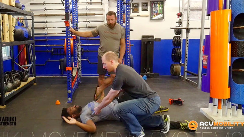 acumobility ball lat mobility for releasing the shoulder with Chris Duffin from Kabuki Strength using the boomstick