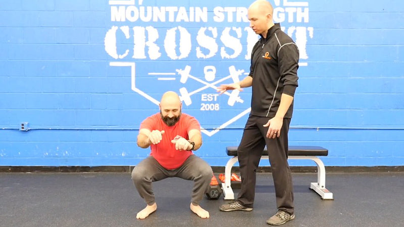 using the acumobility ball and acumobility floss bands to fix ankle pain and ankle mobility in the squat