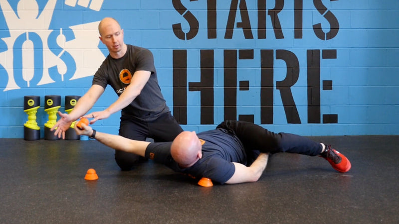 using the acumobility ball to improve shoulder trigger points to fix shoulder pain and shoulder mobility