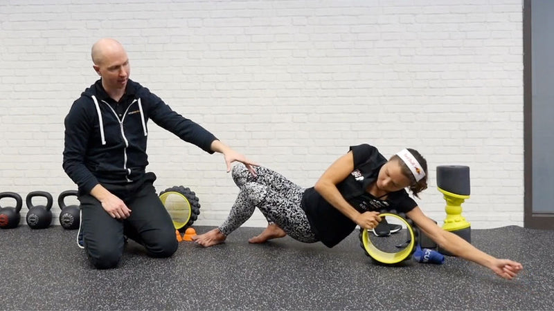 using the acumobility ultimate back roller to work trigger points in the back and shoulders for triathletes