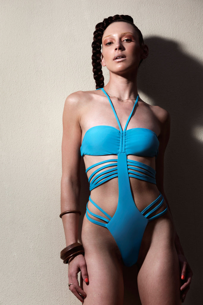The Kyle is a blue racy cage monokini One Piece on front view of swimsuit model